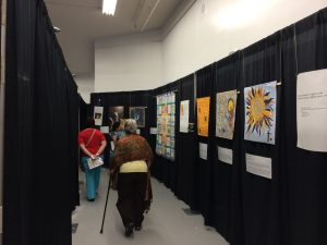 Solar Sister exhibit at Mancuso Quilt Festival