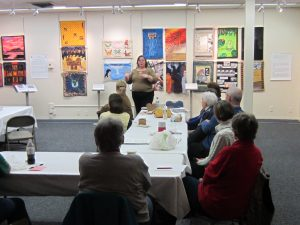 Allison Wilbur giving a Brown Bag lunch talk on Charity Quilt Projects