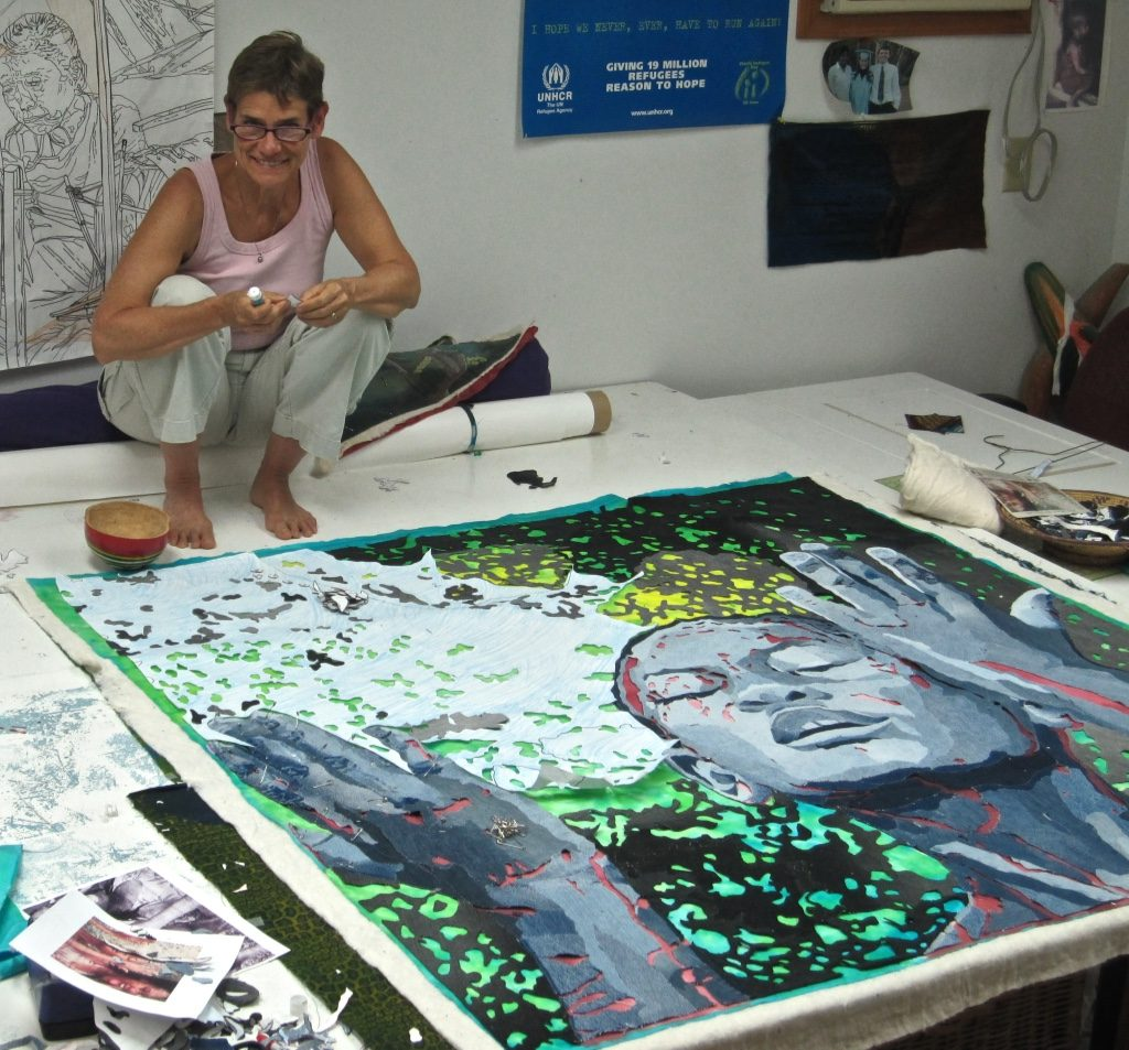 Artist Hollis Chatelain working on her piece Source of Life