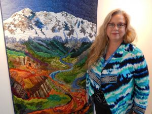 Luana Rubin and her quilt, Rocky Mountain Poison
