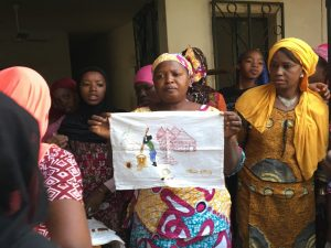 Massaran Traore trains survivors in embroidery and co-manages Sini Brodage