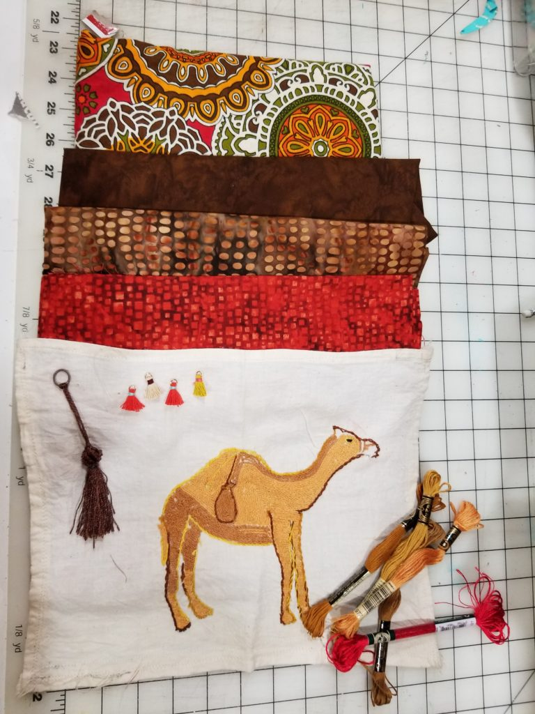 Cathey LaBonte auditioning fabrics for the camel block
