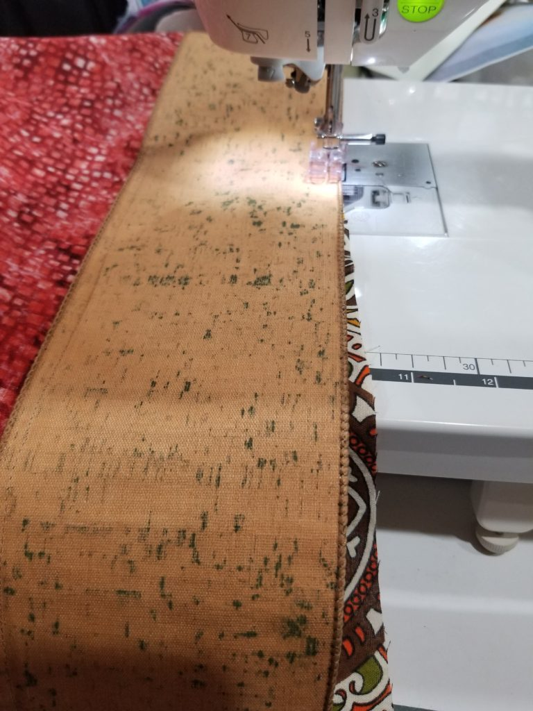 Cathey LaBonte adding cork fabric to her camel quilt