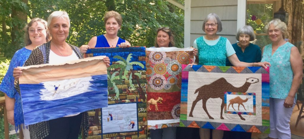 American quilters with their finished Sister Artists quilts